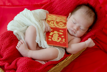New born baby girl with gesture of happy chinese new year