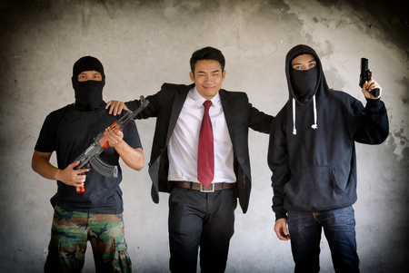 Businessman with bodyguards gangster Editorial