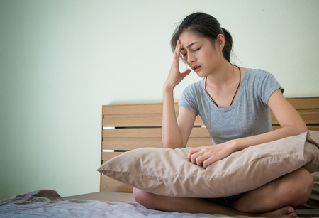 Young pregnant woman feeling unwell , suffering from morning sickness. Stock Photo