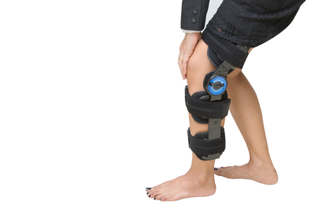 knee support brace on patient leg isolate onwhite