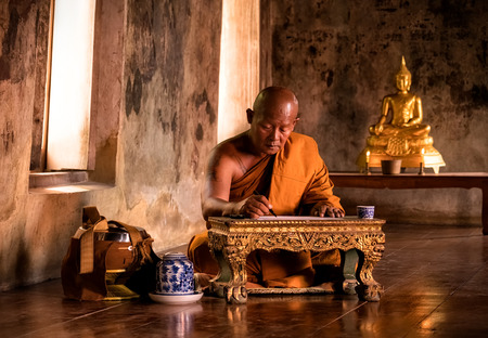 Buddhist monk reading book in the ancient church Stock fotó - 90456465