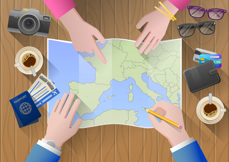 adventurous: Planning a trip to Europe. Young couple adventurous. Travel agency chooses the tour desk. top view Stock Photo