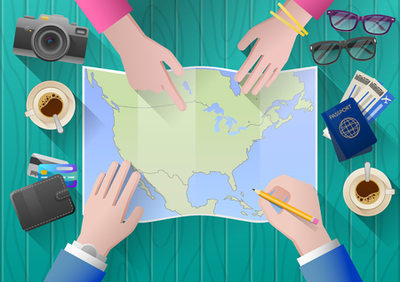 adventurous: Planning a trip to North America. Young couple adventurous. Travel agency chooses the tour desk. top view