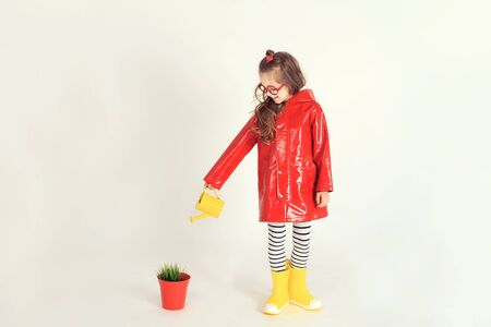 lacquered: Girl is watering plant in the pot