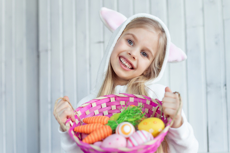 Little girl with Easter wicker basket Stock Photo