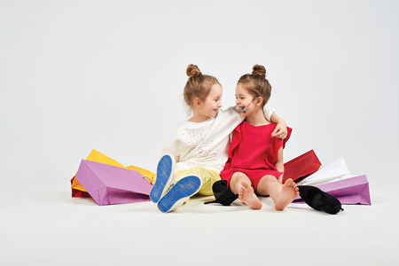 oversize: Girls are sitting hugging each other