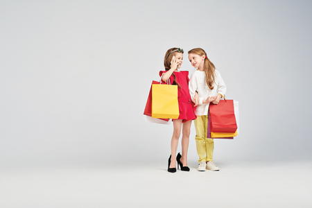 Girls are standing with shoppers bags Stock Photo