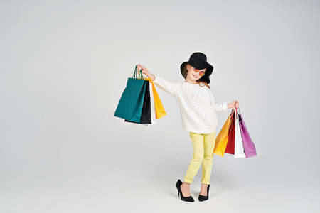 Girl with shoppers bags Stock Photo