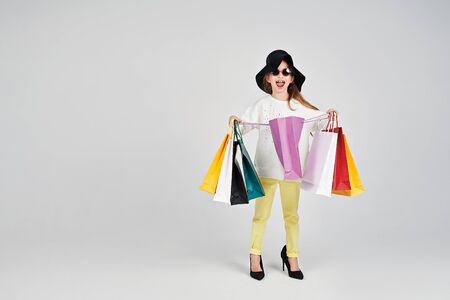Girl is opening a shoppers bag