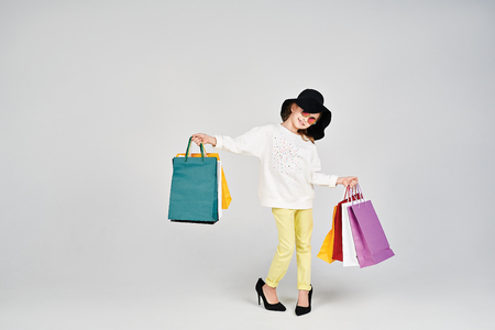 oversize: Girl with shoppers bags Stock Photo