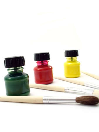 Paint brushes with paint bottles
