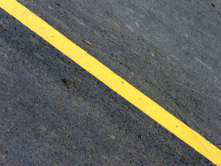 yellow diagonal road line Stock Photo