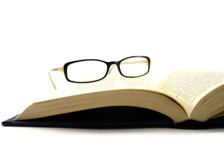Dictionary book with womens glasses