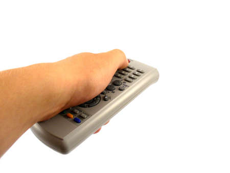 changing channel: hand holding remote control and changing channel