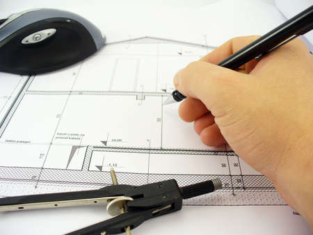 architects hand drawing on blueprints