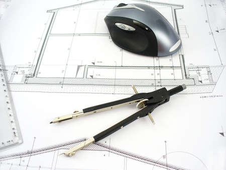 compass with mouse and part of ruler on a blueprint Stock Photo