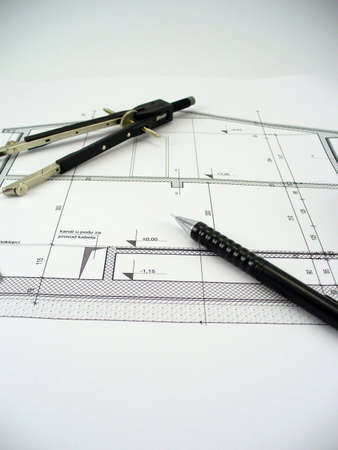blueprint of a house with compass and pen on it Stock Photo