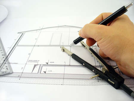 architect on work with pen and compass on the side