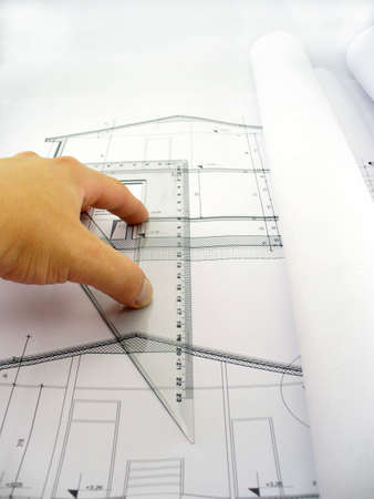 hand measuring on blueprints