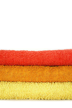 red bathrobe: Towels isolated, towel layers in sauna isolated on white Stock Photo