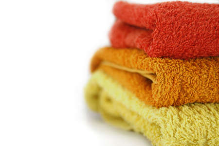 Asciugamani isolate, asciugamano livelli in sauna isolato su bianco