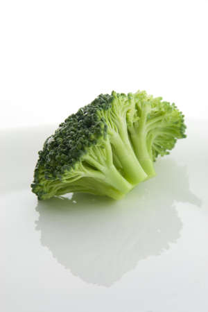 Broccoli on a white plate Stock Photo