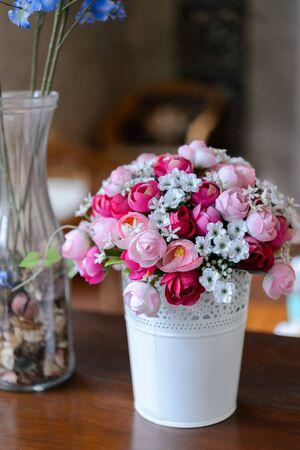 fake: Fake flower on wood table