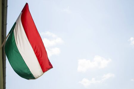 breeze: hungarian flag flying from building in light breeze Stock Photo