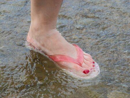 Leg on the water Stock Photo