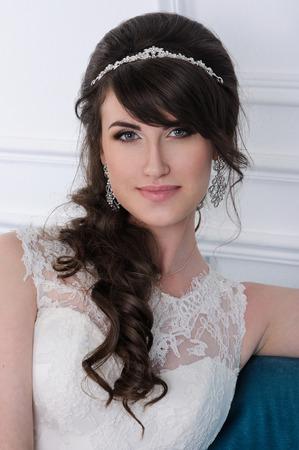 jewess: Close up of beautiful woman wearing shiny diamond earrings