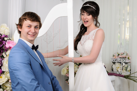 jewess: Close up of funny woman and man. Wedding dress. Wedding accessories Stock Photo