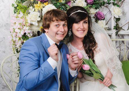 jewess: Close up of beautiful woman and man. Wedding dress. Wedding accessories