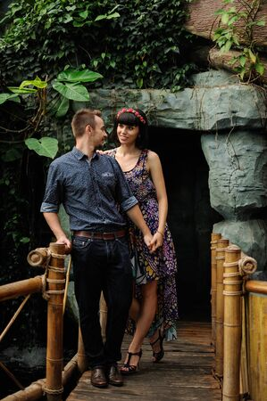 romantic date: Couple on a walk in romantic place botanical garden, on date, love story