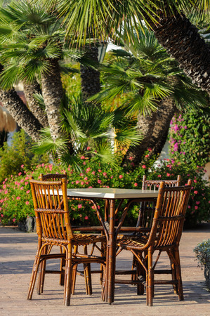 wicker bar: Tables and wicker chairs in the outdoor restaurant in Italy Stock Photo