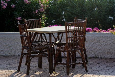 Tables and wicker chairs in the outdoor restaurant in Italy Фото со стока