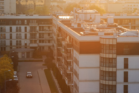Krakow city architecture with sunset across horizon. Urban background,sunny haze