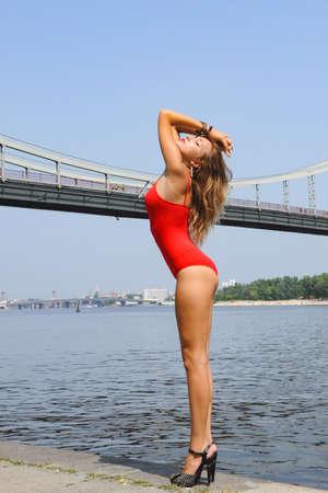Portrait beautiful sexy women in fashion red bodysuit outdoor river summer