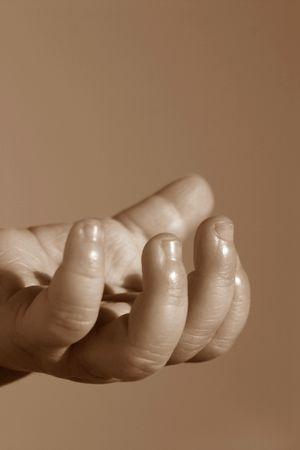 hand held: Bambino fino a mano  Archivio Fotografico
