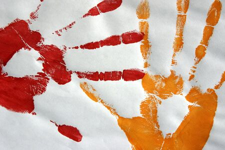 palmistry: Two handprints made with paint on paper.