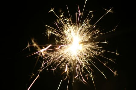 hurray: Sparkles of light, coming from a fireworks stick kids use at the New Year Celebration. Or at a cake. Or in an icecream. Stock Photo