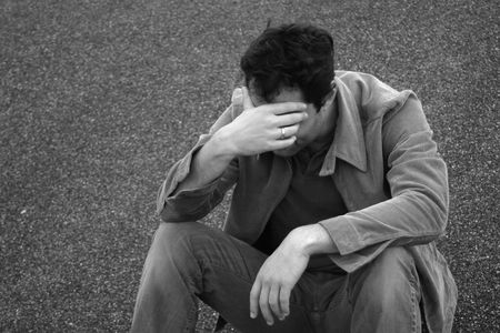 heartbroken: Man holds his head down in sadness