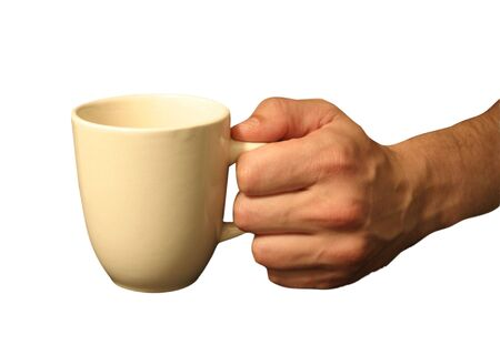 Mans hand holding a cup of... Stock Photo