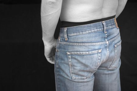 back pocket: Nice Jeans, male body in bw, jeans in color. [Note for inspector: Removed the stitches on pockets to avoid copyright.] Stock Photo