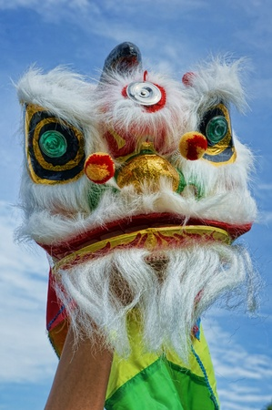 Chinese new year  lion dance with blue sky Stock Photo - 21196705