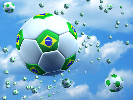 Soccer balls with Brazilian flag on the air photo