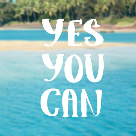 sayings: Yes You Can. Inspirational quote on blurred landscape background