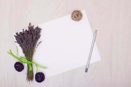 Lavender flowers and empty photo album book cover. Floral frame from dried plants. Flat lay background