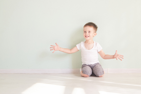 Happy cute child reaching out his palms and catching something. Reklamní fotografie