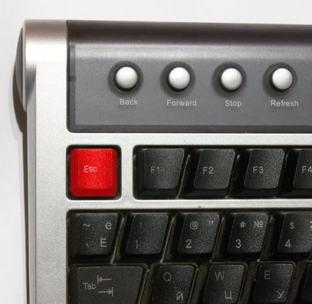 command button: Part of the computer keyboard with accented key ESC. A key of red color.