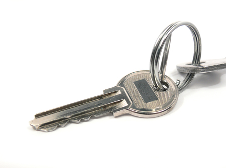 Key from the house. It is partially visible on a picture and the second key which is connected to the first by ring. Stock Photo - 1566794